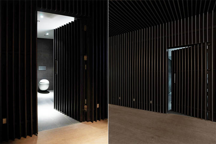 Bức tường nhà vệ sinh cũng sử dụng lam gỗ