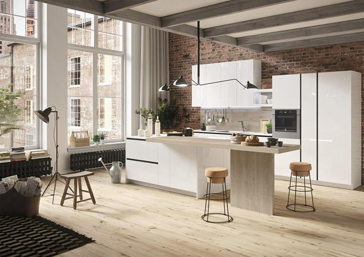 Bàn đảo được tận dụng để chia nhỏ không gian bếp một cách tinh tế